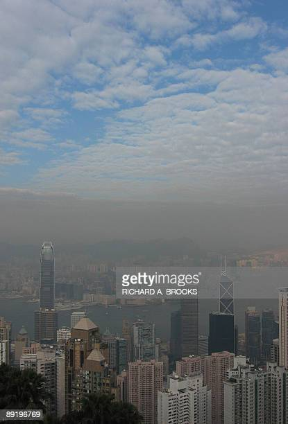 """File photo taken December 24, 2008 shows the view from """"The Peak"""" in Hong Kong, and a level of haze hanging over Victoria harbour while blue skies..."""