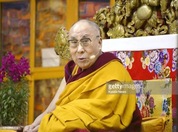 File photo taken Feb. 20 shows the Dalai Lama, Tibet's exiled spiritual leader, preaching in the northern Indian city of Dharamsala.