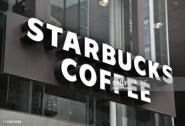 File photo taken Feb 27 in Tokyo's Chuo ward shows the logo of Starbucks ==Kyodo