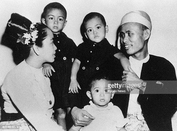 File photo taken in 1947 shows family of Myanmar opposition leader Aung San Suu Kyi when she was two years old herself her father Gen Aung San her...