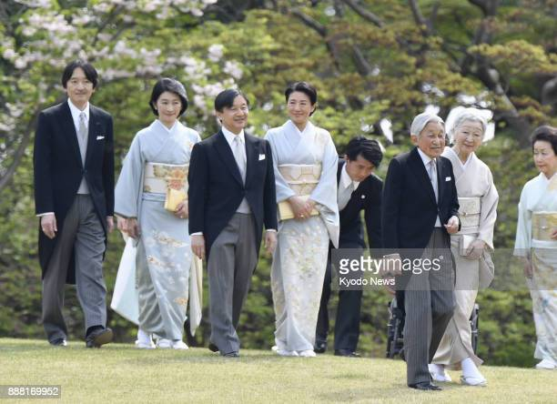 File photo taken in April 2017 of the Japanese imperial family including Emperor Akihito and Empress Michiko at a garden party at the Akasaka...