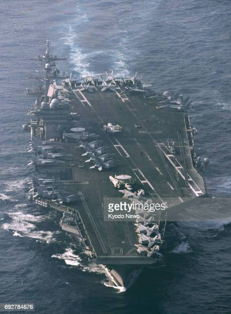 File photo taken in April 2017 shows the US aircraft carrier Carl Vinson The Carl Vinson and the Ronald Reagan which had been deployed in the Sea of...