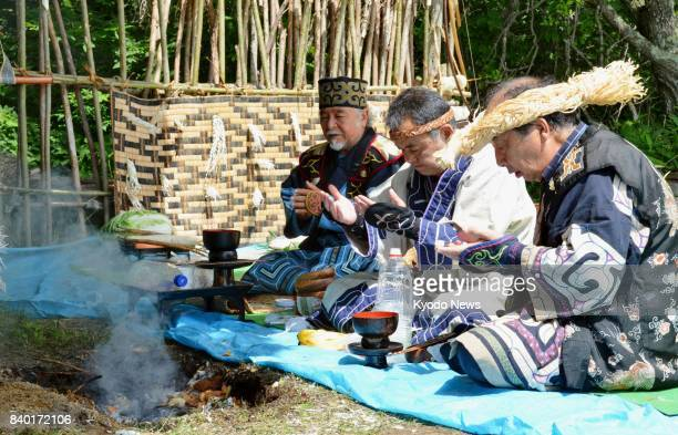 File photo taken in August 2015 in the town of Shiranuka on the northernmost Japanese main island of Hokkaido shows members of the Ainu indigenous...