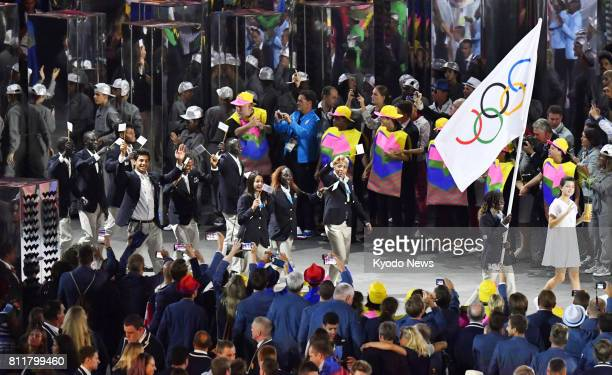 File photo taken in August 2016 shows the Refugee Olympic Team marching during the opening ceremony of the Rio de Janeiro Olympics at the Maracana...
