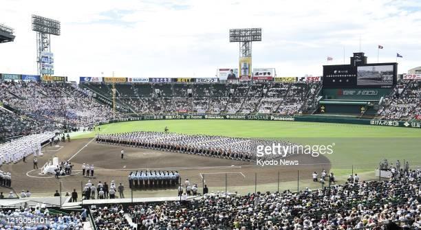 File photo taken in August 2019 shows the opening ceremony of Japan's National High School Baseball Championship at Koshien Stadium in Nishinomiya,...