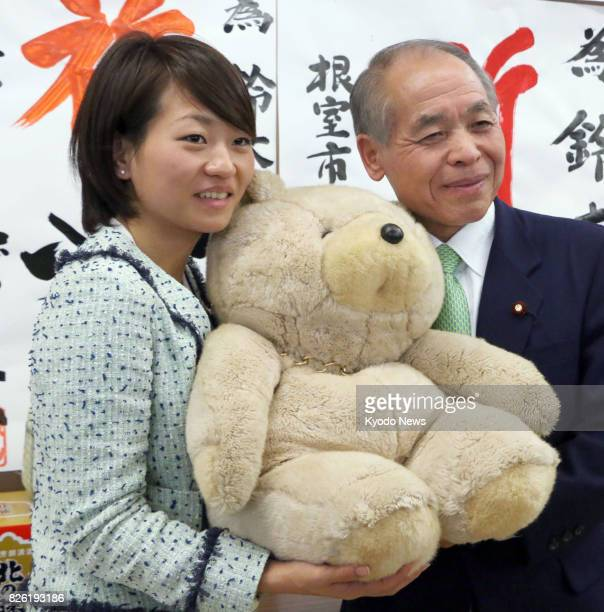File photo taken in December 2014 shows House of Representatives lawmaker Takako Suzuki and her father Muneo a former lower house lawmaker in Kushiro...