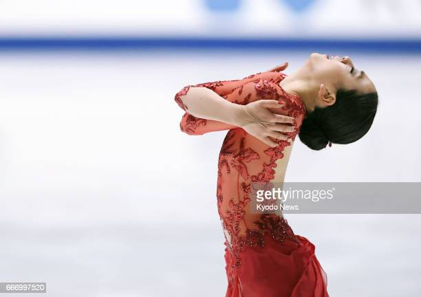 File photo taken in December 2016 in the western Japan prefecture of Osaka shows threetime figure skating world champion Mao Asada completing her...