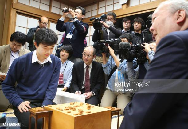 File photo taken in December 2016 shows Japan's youngest professional shogi player 14yearold Sota Fujii after defeating the country's oldest...