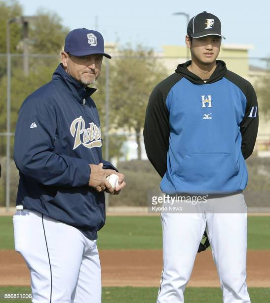 File photo taken in February 2016 shows former San Diego Padres closer Trevor Hoffman and Nippon Ham Fighters pitcherslugger Shohei Otani during the...