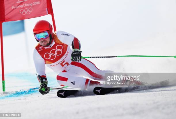 File photo taken in February 2018 shows Alpine skier Marcel Hirscher competing en route to winning the men's giant slalom at the Pyeongchang Winter...