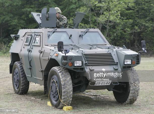 File photo taken in Hiroshima Prefecture in May 2008 shows a Japanese Ground Self-Defense Force light-armored vehicle, developed by major machinery...