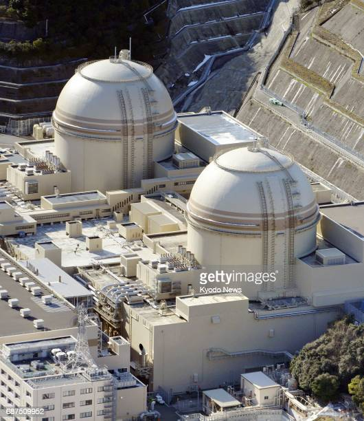 File photo taken in January 2017 shows Nos 3 and 4 reactors of Kansai Electric Power Co's Oi plant on the Sea of Japan coast The Nuclear Regulation...