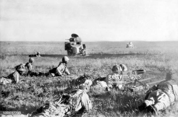 File photo taken in July 1939 shows Japanese Imperial Army soldiers crawling forward near an abandoned Soviet tank on the border between Mongolia and...