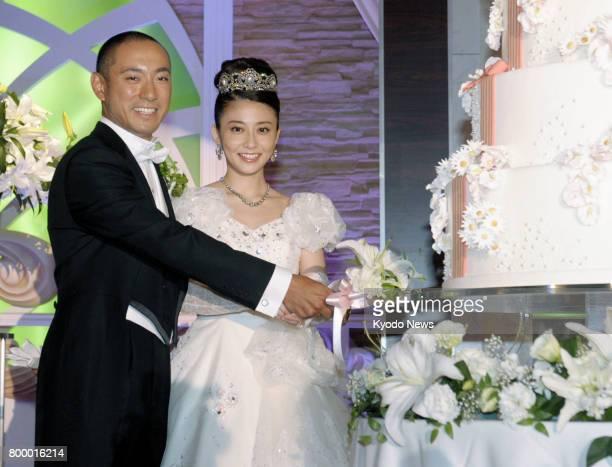 File photo taken in July 2010 shows Japanese kabuki star Ichikawa Ebizo and TV personality Mao Kobayashi during their wedding reception at a Tokyo...