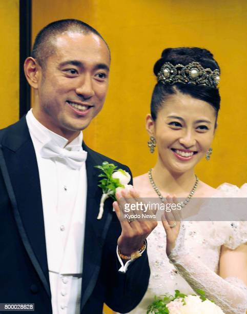 File photo taken in July 2010 shows Japanese kabuki star Ichikawa Ebizo and TV personality Mao Kobayashi during a press conference following their...