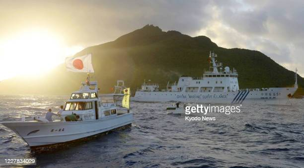 File photo taken in July 2013 shows a Chinese maritime surveillance vessel passing near the Senkaku Islands in the East China Sea Japan urged China...