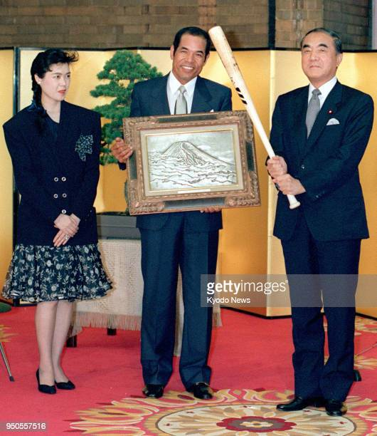 File photo taken in June 1987 shows Sachio Kinugasa of the Hiroshima Carp posing during a ceremony held at the prime minister's office in Tokyo to...