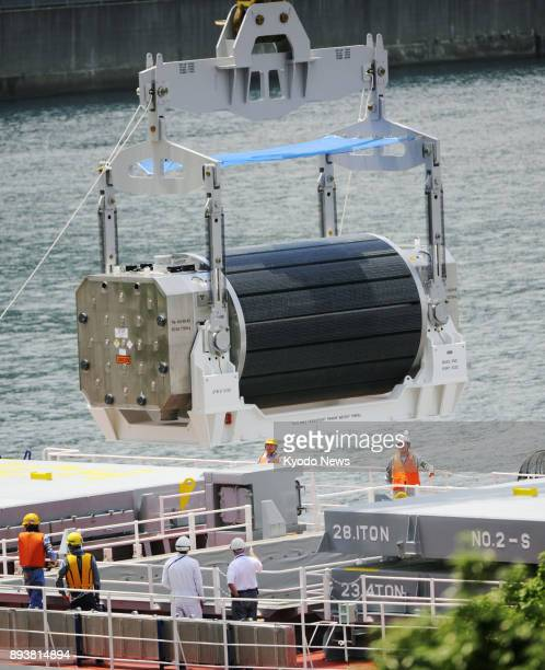 File photo taken in June 2010 shows a mixed oxide fuel cask being unloaded from a transport vessel that arrived at Kansai Electric Power Co's...