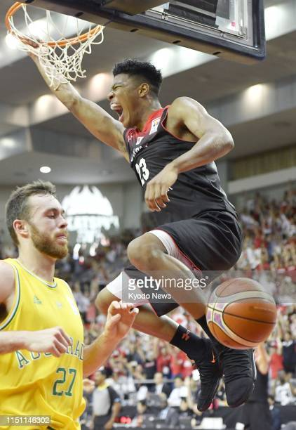 File photo taken in June 2018 shows Rui Hachimura hanging on the rim after a dunk for Japan's national basketball team in a World Cup qualifier...