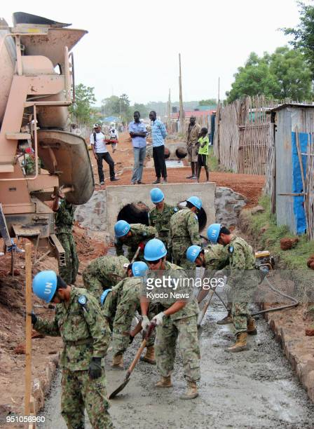 File photo taken in March 2013 shows Japan SelfDefense Forces personnel engaging in construction work in Juba the capital of South Sudan as part of...