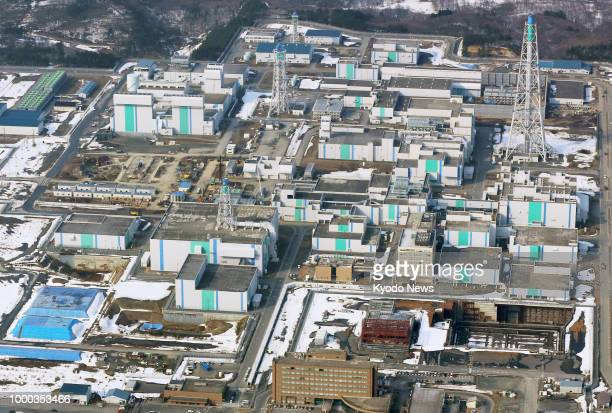 File photo taken in March 2014 shows a spent nuclear fuel reprocessing plant in Rokkasho Aomori Prefecture northeastern Japan The plant is seen as a...