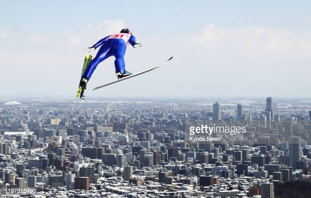 File photo taken in March 2017 shows a ski jumper soaring through the air at a competition in Sapporo. The Japanese Olympic Committee gave Sapporo...