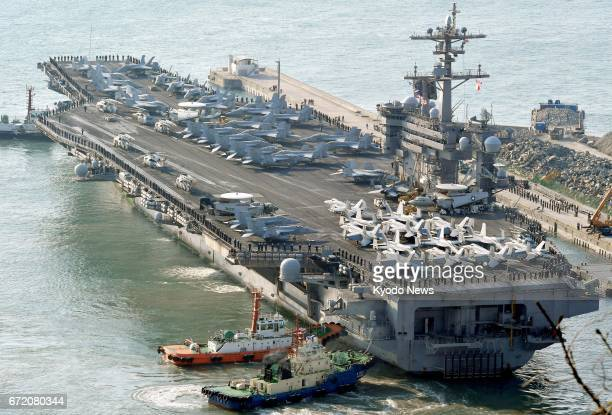 File photo taken in March 2017 shows the USS Carl Vinson aircraft carrier arriving at the port of Busan South Korea The South Korean Defense Ministry...