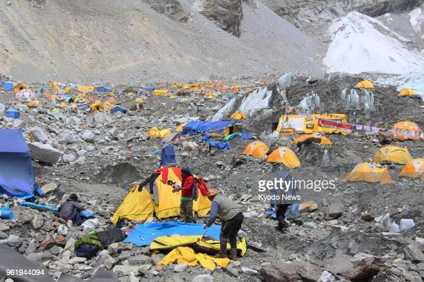 File photo taken in May 2013 shows tents set up on a glacier at a base camp of Mt Everest in Nepal ==Kyodo