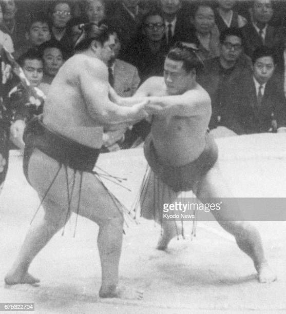 File photo taken in November 1965 shows yokozuna Sadanoyama forcing another yokozuna Taiho out of the ring at the Kyushu Grand Sumo Tournament in...