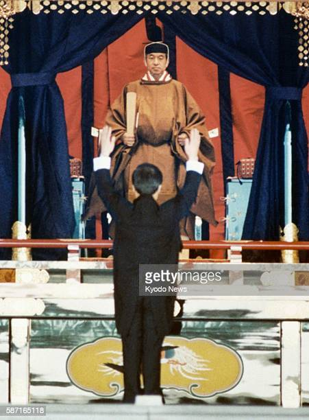 File photo taken in November 1990 shows Japanese Emperor Akihito proclaiming his accession one of the enthronement ceremonies in the MatsunoMa State...