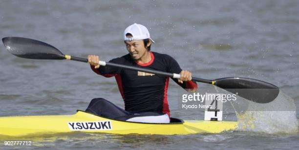 File photo taken in November 2010 shows Japanese canoeist Yasuhiro Suzuki competing at the Asian Games in Guangzhou China Suzuki has been banned from...