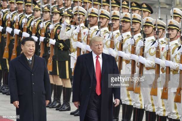 File photo taken in November 2017 shows US President Donald Trump and Chinese President Xi Jinping attending a welcome ceremony in Beijing Trump...