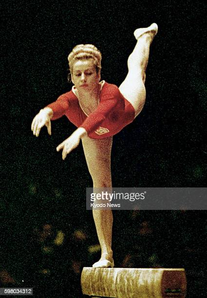 File photo taken in October 1964 shows Czech gymnast Vera Caslavska performing on the balance beam at the Tokyo Olympic Games Caslavska who claimed a...