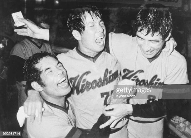 File photo taken in October 1975 shows Sachio Kinugasa of the Hiroshima Carp celebrating the team's first Central League title with teammate Koji...
