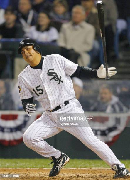File photo taken in October 2005 shows Tadahito Iguchi hitting a single for the Chicago White Sox in Game 2 of the World Series against the Houston...