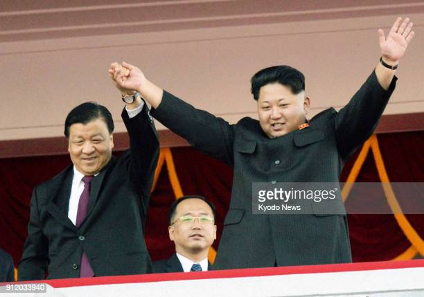 File photo taken in October 2015 shows North Korean leader Kim Jong Un and Liu Yunshan a member of the Standing Committee of the Chinese Communist...