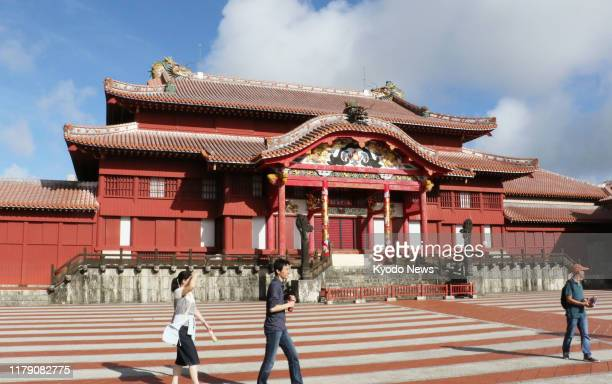 File photo taken in October 2016 shows the main building of Shuri Castle a World Heritage site in Naha Okinawa Prefecture southern Japan