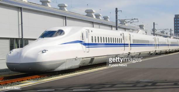 File photo taken in October 2018 shows the new N700S shinkansen bullet train at Central Japan Railway Co's rail yard in Hamamatsu Shizuoka Prefecture...