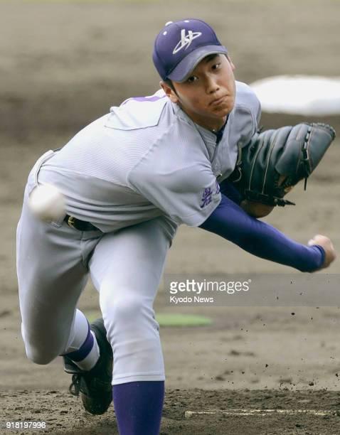 File photo taken July 26 shows Shohei Ohtani pitching at a high school baseball tournament in Morioka, Japan. ==Kyodo