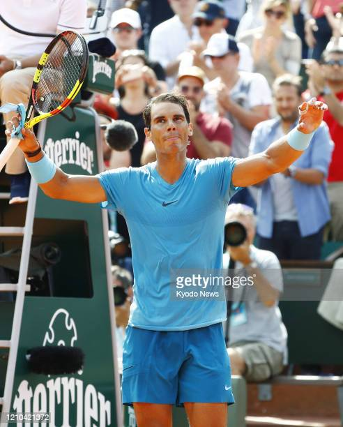 File photo taken June 2 shows Rafael Nadal of Spain reacts after beating Richard Gasquet of France in the third round of the French Open tennis...