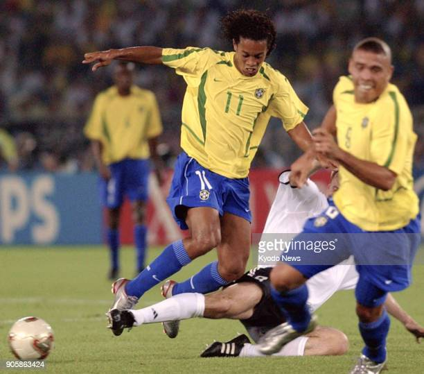 File photo taken June 30 shows Brazil's Ronaldinho being tackled in the World Cup final against Germany in Yokohama The former Barcelona star has...