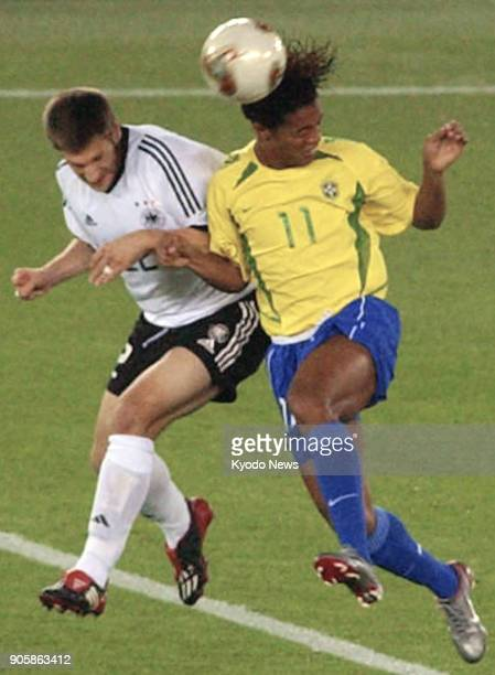 File photo taken June 30 shows Brazil's Ronaldinho vying for the ball with Torsten Frings of Germany in the World Cup final in Yokohama The former...