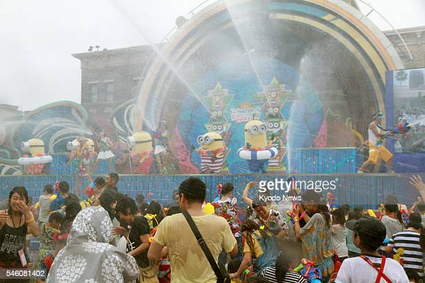 File photo taken June 30 shows Universal Studios Japan's Water REBOOOOOOOORN Party The 4980 yen admission fee will be waived for one child when...