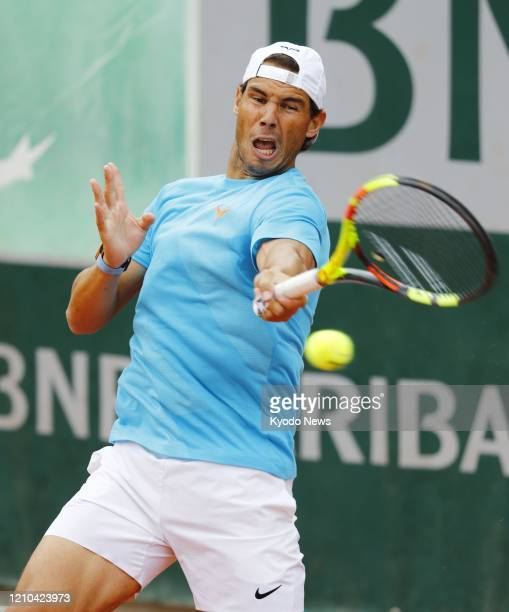File photo taken June 4 shows Rafael Nadal of Spain warming up ahead of his quarterfinal match against Japan's Kei Nishikori at the French Open...