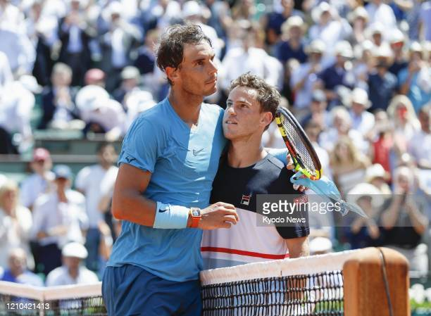 File photo taken June 7 shows Rafael Nadal of Spain meets Diego Schwartzman after beating the Argentine at the quarterfinals of the French Open...