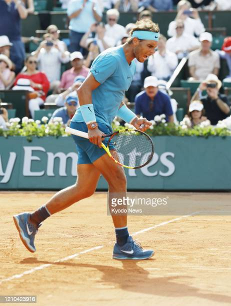File photo taken June 8 shows Rafael Nadal of Spain celebrating after beating Juan Martin del Potro of Argentina at the semifinals of the French Open...