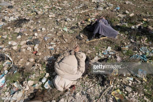 Image depicts death.) A file photo taken on 30 January 2017 in Mosul, Iraq show the dead bodies of victims of execution. Two men with tied hands were...