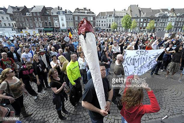 A file photo taken on April 27 2012 shows a demonstrator holding a giant joint of marijuana in the southeastern Dutch city of Maastricht to protest...