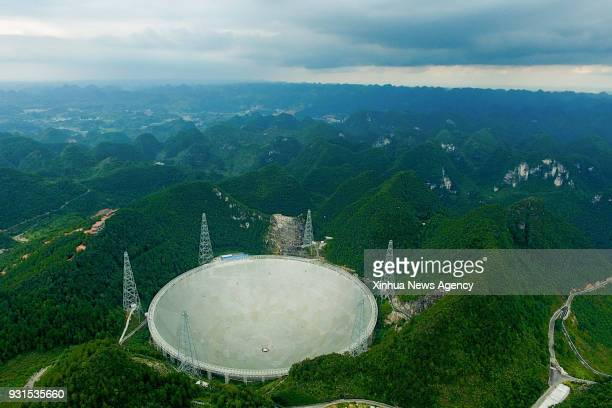 GUIYANG CHINA AUGUST 9 2017 File photo taken on Aug 9 shows the Fivehundredmeter Aperture Spherical Radio Telescope in Pingtang County southwest...
