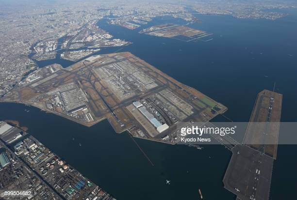 File photo taken on Dec 23 shows an aerial view of Tokyo's Haneda airport ==Kyodo
